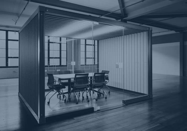 Office interior featuring acoustic pod as meeting room