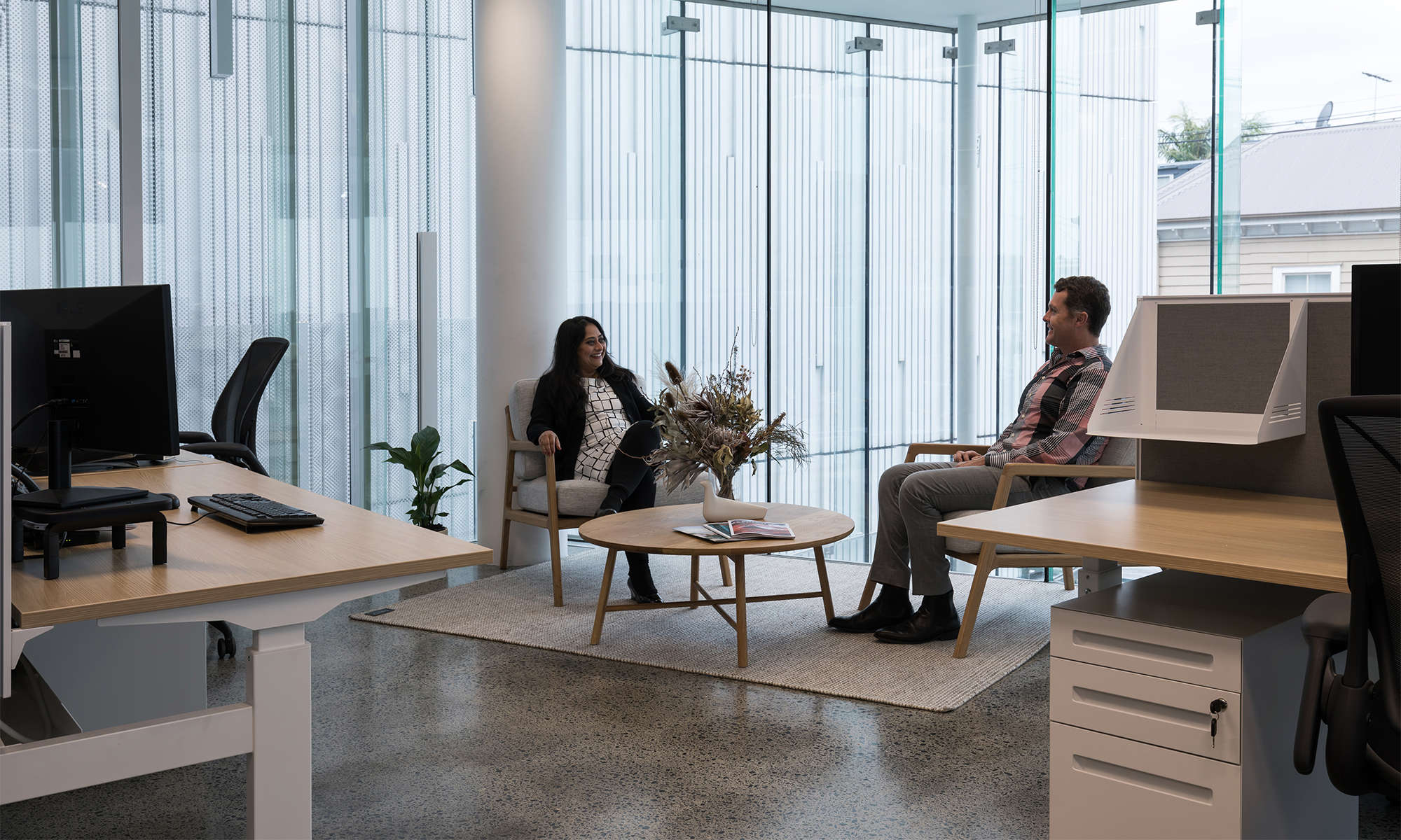 Workers sitting in modern European office furniture